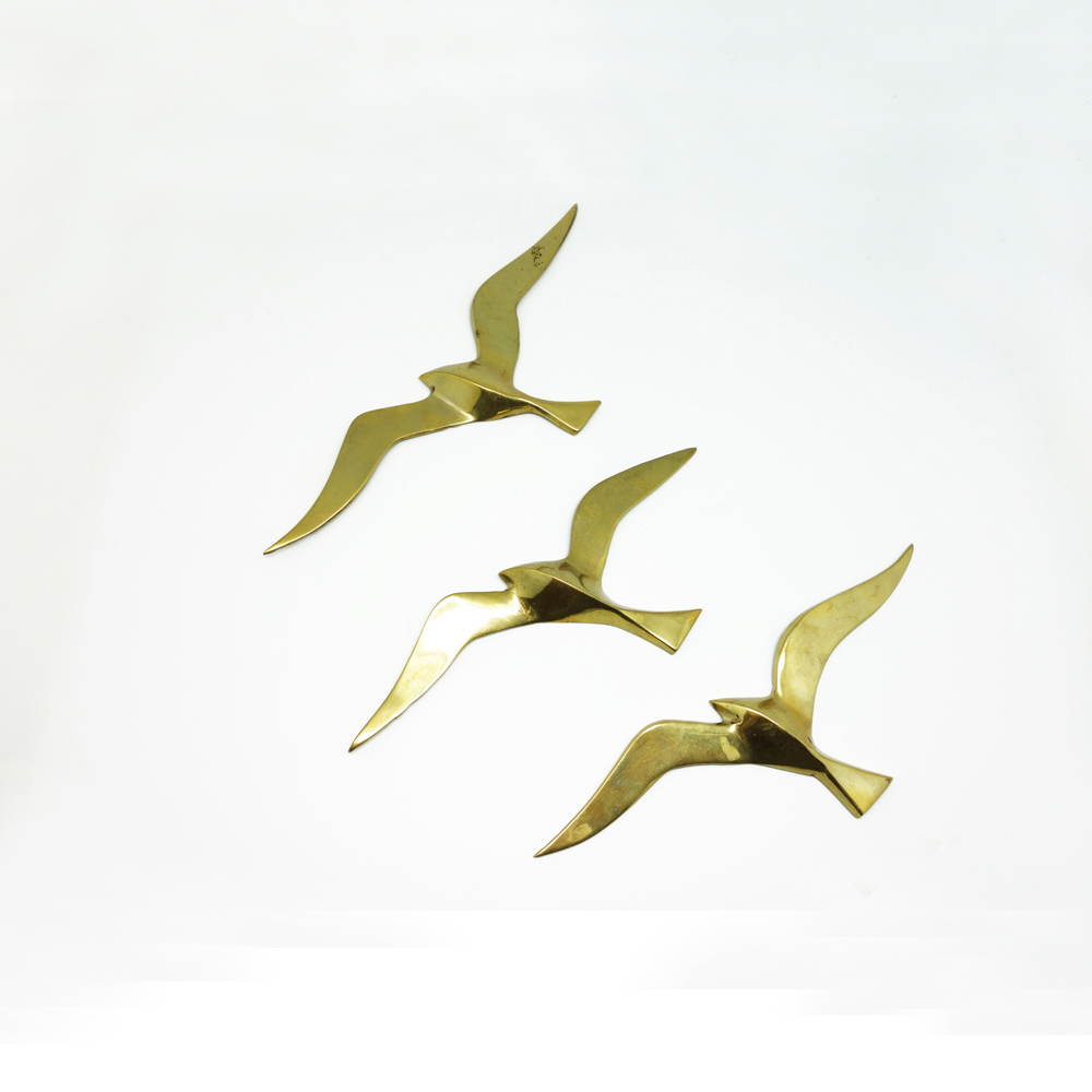 Decorative brass birds.